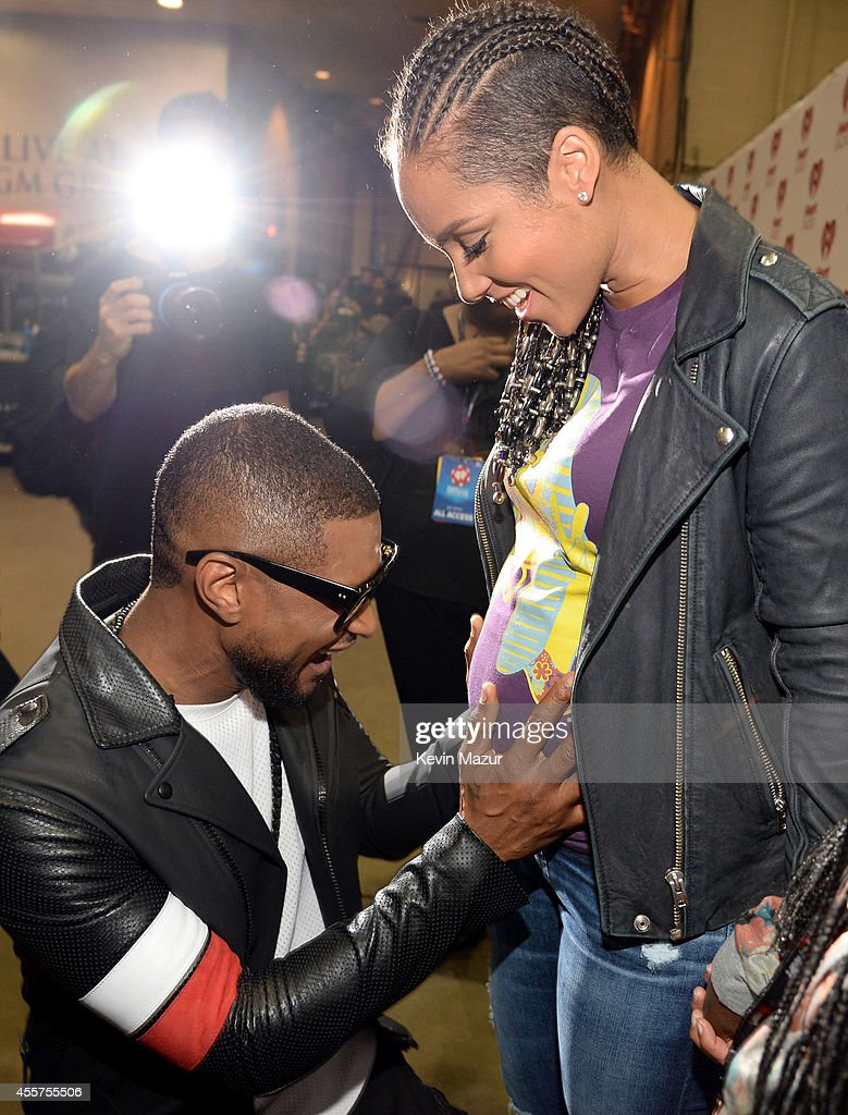 Recording artists Usher and Alicia Keys attend the 2014 iHeartRadio Music Festival at the MGM Grand Garden Arena on September 19 2014 in Las Vegas...