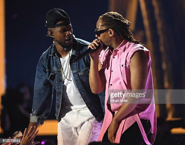 Recording artists Usher and Lil Jon perform onstage at the 2016 iHeartRadio Music Festival at TMobile Arena on September 24 2016 in Las Vegas Nevada