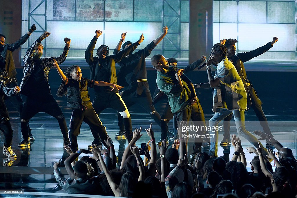 Recording artists <a gi-track='captionPersonalityLinkClicked' href=/galleries/search?phrase=Usher+-+Singer&family=editorial&specificpeople=201477 ng-click='$event.stopPropagation()'>Usher</a> (3rd R) and <a gi-track='captionPersonalityLinkClicked' href=/galleries/search?phrase=Young+Thug+-+Rapper&family=editorial&specificpeople=13617846 ng-click='$event.stopPropagation()'>Young Thug</a> (2nd R) perform onstage during the 2016 BET Awards at the Microsoft Theater on June 26, 2016 in Los Angeles, California.