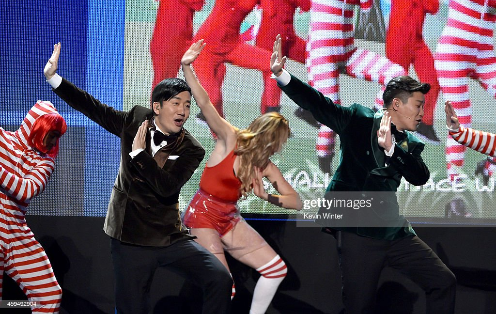 Recording artists Wang Taili (L) and Xiao Yang (R) of the Chopstick Brothers perform onstage at the 2014 American Music Awards at Nokia Theatre L.A. Live on November 23, 2014 in Los Angeles, California.