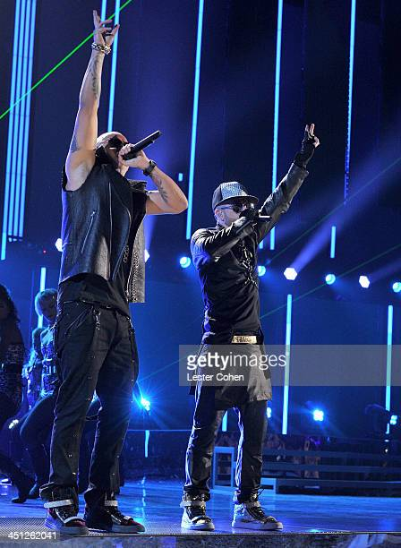 Recording artists Wisin and Yandel of Wisin Y Yandel perform onstage during The 14th Annual Latin GRAMMY Awards at the Mandalay Bay Events Center on...