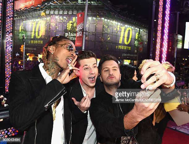 Recording artists Wiz Khalifa Charlie Puth and Luke Bryan pose at the Dick Clark's New Year's Rockin' Eve with Ryan Seacrest 2016 on December 31 2015...