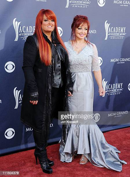 Recording Artists Wynonna Judd and mother Naomi Judd of The Judds arrive at the 46th Annual Academy Of Country Music Awards at MGM Grand on April 3...