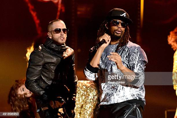 Recording artists Yandel and Lil Jon perform onstage during Telemundo's Latin American Music Awards at the Dolby Theatre on October 8 2015 in...