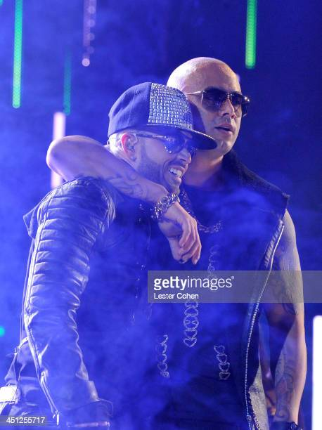 Recording artists Yandel and Wisin of Wisin Y Yandel perform onstage during The 14th Annual Latin GRAMMY Awards at the Mandalay Bay Events Center on...