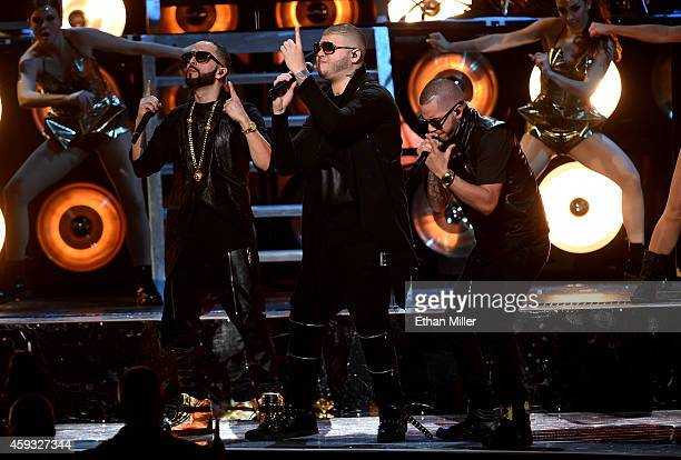 Recording artists Yandel Farruko and El General Gadiel perform onstage during the 15th Annual Latin GRAMMY Awards at the MGM Grand Garden Arena on...