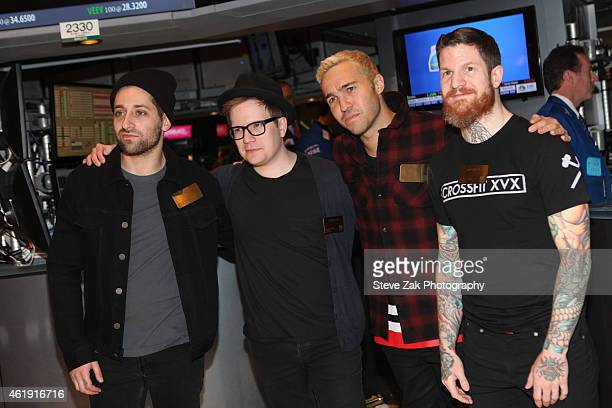 Recording artists/musicians Joe Trohman Patrick Stump Pete Wentz and Andy Hurley of Fall Out Boy pose for a photo prior to ringing the NYSE closing...