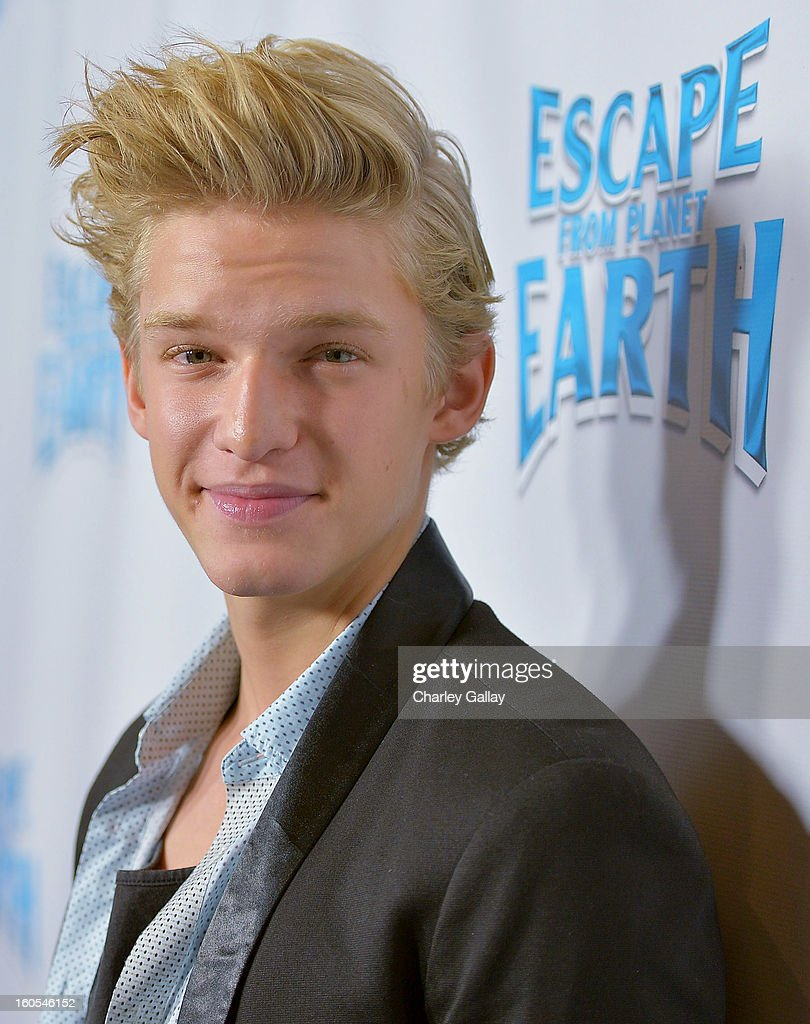 Recording artost Cody Simpson attends the 'Escape From Planet Earth' premiere presented by The Weinstein Company in partnership with Sabra at Mann Chinese 6 on February 2, 2013 in Los Angeles, California.