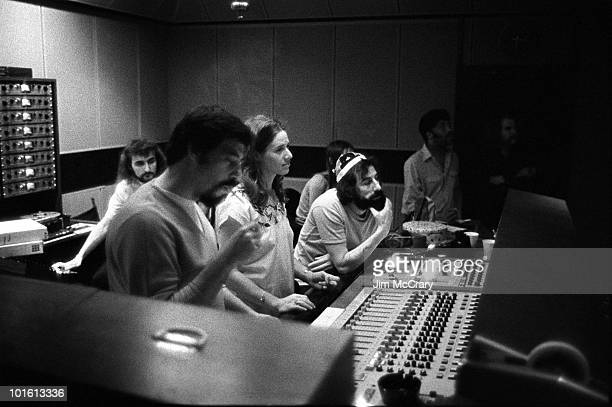 Recording engineer Hank Cicalo Carole King and record producer Lou Adler gather around the mixing desk for a playback in the control room of AM...