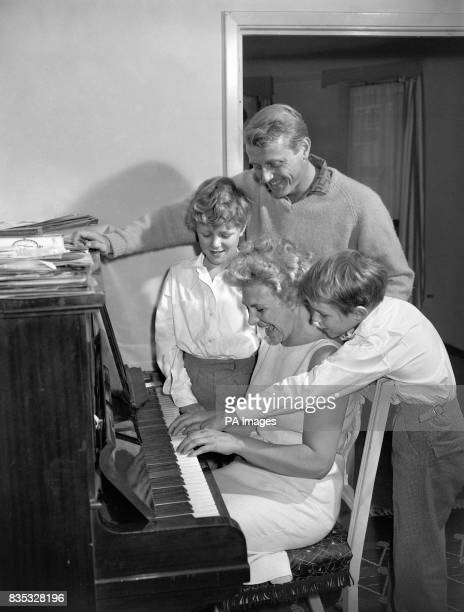 Recording star Gary Miller with his family at the piano during a rehearsal at his London home for his summer season opening at the Lido Margate Kent...