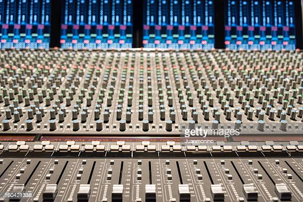 Recording studio with mixing console.