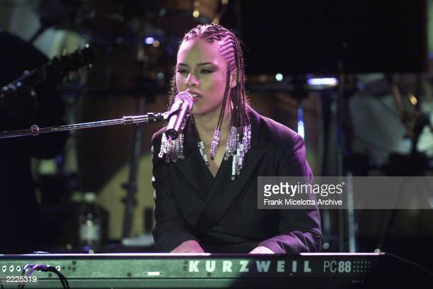 J Records artist Alicia Keys performs at the 26th Annual Clive Davis PreGrammy Party at the Beverly Hills Hotel in Los Angeles 2/20/01 Photo by Frank...