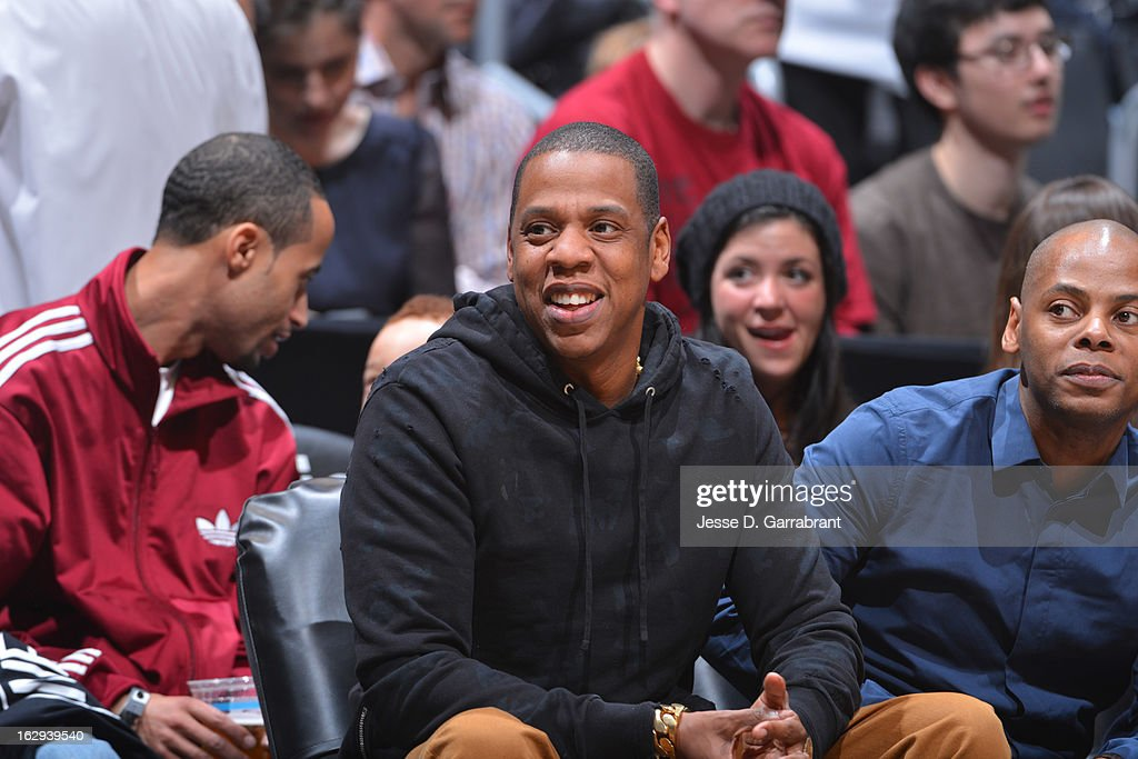 Recorind Artist, Jay-Z, watches the game between the Dallas Mavericks and the Brooklyn Nets on March 1, 2013 at the Barclays Center in Brooklyn, New York.