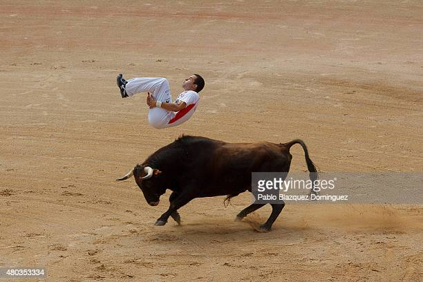 A 'recortador' jumps over a bull in the bullring during the sixth day of the San Fermin Running Of The Bulls festival on July 11 2015 in Pamplona...