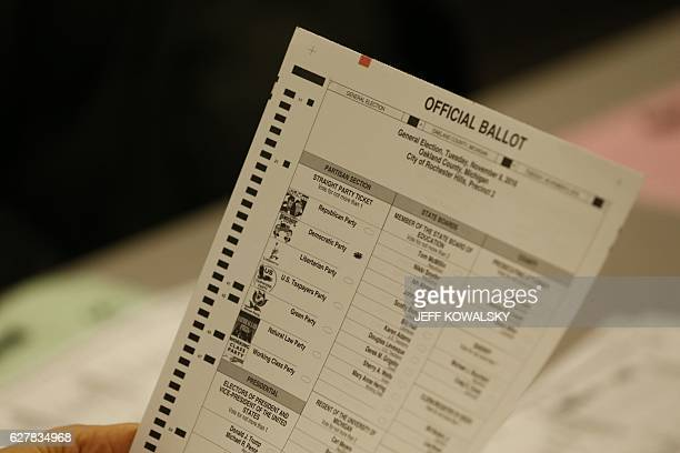 A recount of ballots cast in Oakland County Michigan from the 2016 US presidential race are seen at the Oakland County Schools building on December 5...