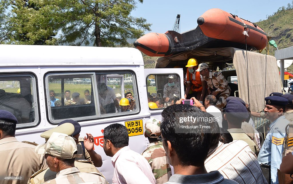 Recovered body being loaded in ambulance for postmortem in zonal hospital on June 12, 2014 in Mandi, India. Two more bodies were recovered from the river. A wall of water washed away 24 engineering students and a tour operator Sunday evening after water was released into the river allegedly without a warning from a nearby Pandoh Dam on Beas River.
