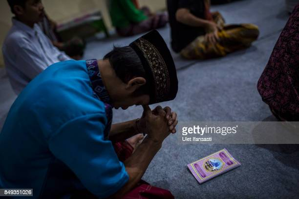 A recovering drug addict prays during a prayer session led by Ustad Ahmad Ischsan Maulana the head of Nurul Ichsan Al Islami traditional...