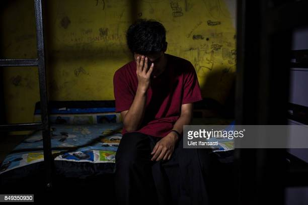 A recovering drug addict Rois has been a drug addict for four years poses for a photograph in his room at Nurul Ichsan Al Islami traditional...