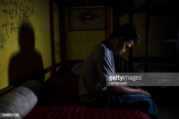 A recovering drug addict Tanto has been a drug addict for three years poses for a photograph in his room at Nurul Ichsan Al Islami traditional...