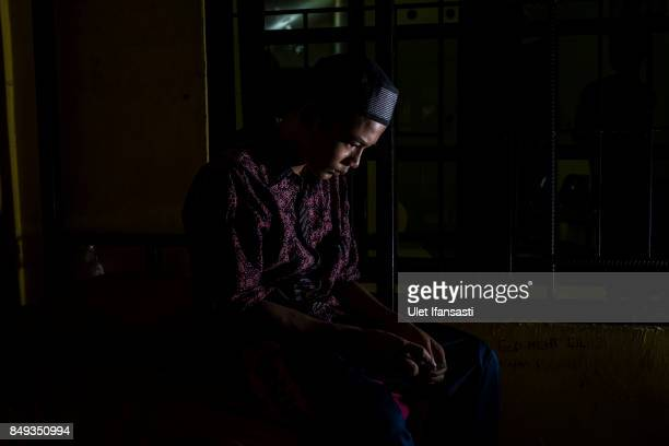 A recovering drug addict Yudha has been a drug addict for seven years poses for a photograph in his room at Nurul Ichsan Al Islami traditional...