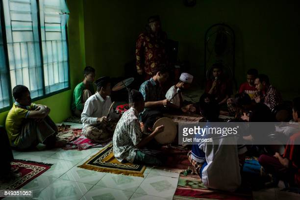 Recovering drug addicts learning islamic music known as 'rebana' in physical activity led by the head of rehabilitation centre Ustad Ahmad Ischsan...