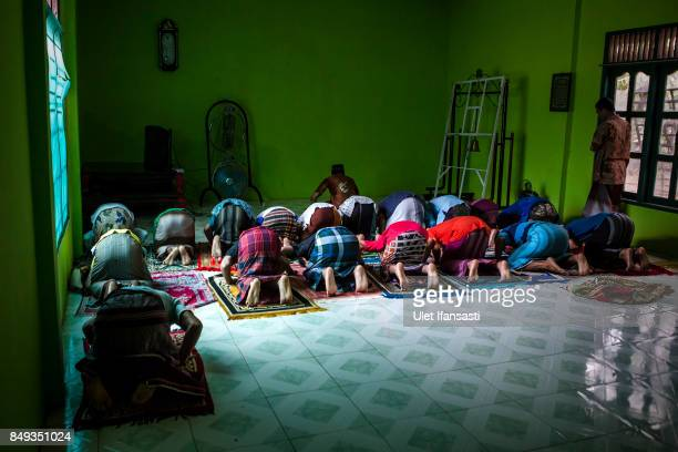 Recovering drug addicts praying at the traditional rehabilitation centre Nurul Ichsan Al Islami on September 15 2017 in Purbalingga Indonesia...
