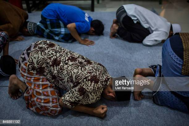 Recovering drug addicts praying during a prayer session led by Ustad Ahmad Ischsan Maulana the head of Nurul Ichsan Al Islami traditional...