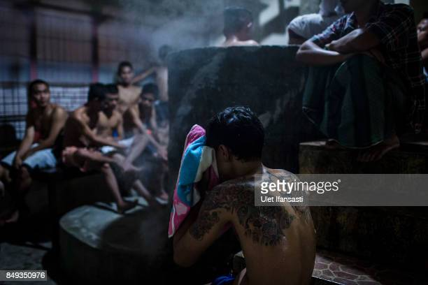 Recovering drug addicts wait for their herbal hot water immersion treatment by the head of rehabilitation centre Ustad Ahmad Ischsan Maulana at the...