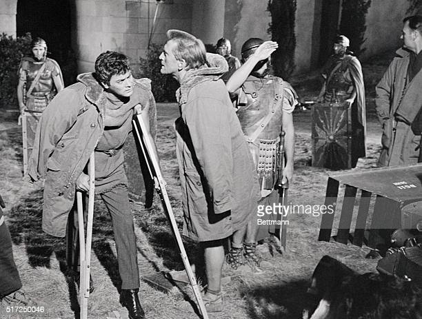 Recovering from surgery for a split Achilles heel actor Tony Curtis returned to work here in the movie Spartacus Using crutches and wearing a parka...