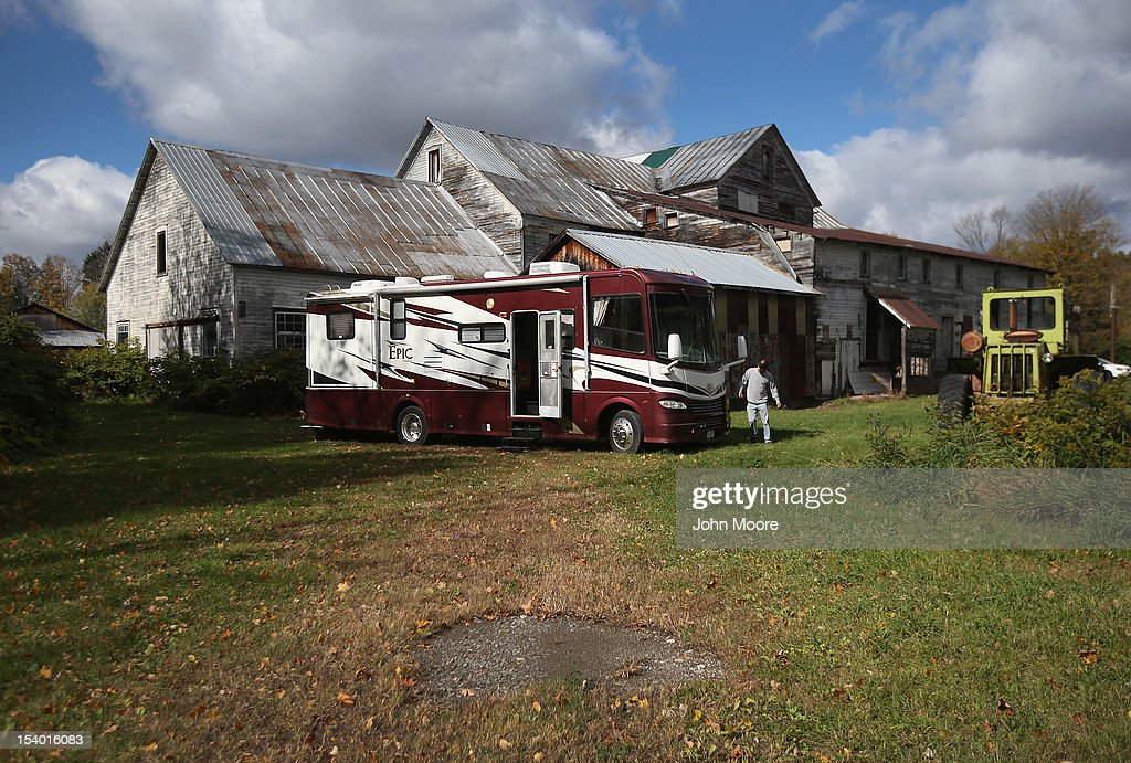 Recovery agent or 'repo man' Jeff Grevelding prepares to reposses an RV parked behind a farm on October 12, 2012 in Lee Center, New York. Grevelding, who works for Advanced Recovery of New York, works with fellow agents day and night locating and towing vehicles legally repossessed by banks and loan agencies, after the owners stop making payments.