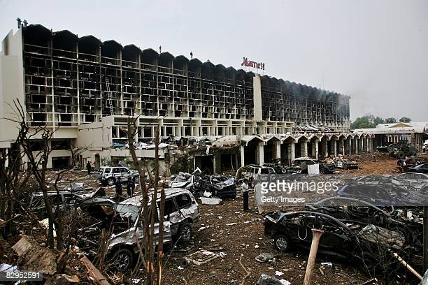 Recovery efforts continue after a suicide truck bombing caused damage outside the Marriott Hotel September 21 2008 in Islamabad Pakistan The massive...