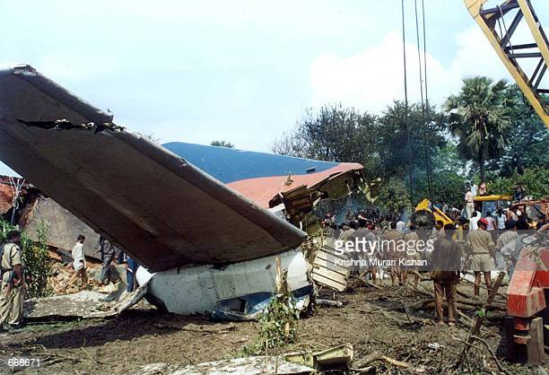 Recovery personnel search through the remains of an Indian Alliance Air aircraft which crashed July 17 2000 in the eastern Indian town of Patna The...