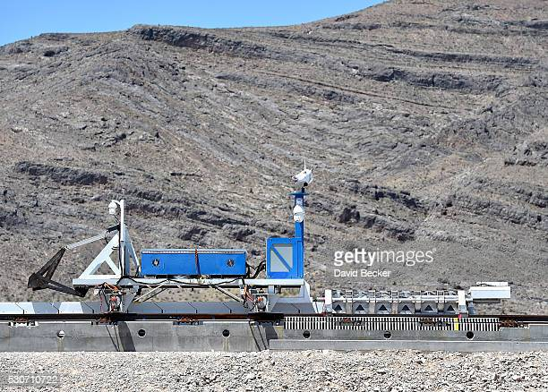 A recovery vehicle moves a test sled down a track after the first test of the propulsion system at the Hyperloop One Test and Safety site on May 11...