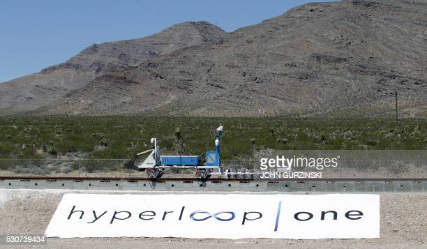 A recovery vehicle pushes a test sled is after it was propelled along a set of tracks during its first propulsion open air test at the Hyperloop One...