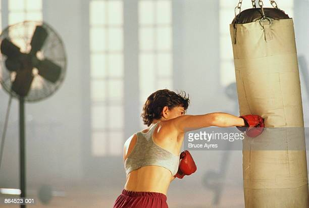 Recreational boxing, woman working out with punching bag