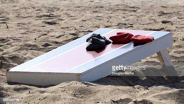 Recreational Cornhole game board and bags on the beach