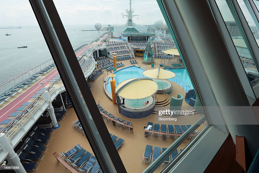 Recreational facilities are seen through a window aboard the Royal Caribbean Cruises Ltd.'s Voyager of the Seas, berthed at the Ohi wharf in Tokyo, Japan, on Saturday, Sept. 14, 2013. Royal Caribbean, the worlds second-largest cruise-line operator, doubled its dividend and will make directors stand for election every year. Photographer: Yuriko Nakao/Bloomberg via Getty Images