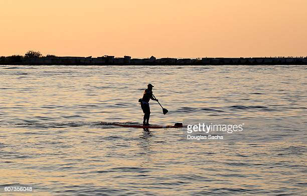 Recreational paddleboarder during the dusk hour