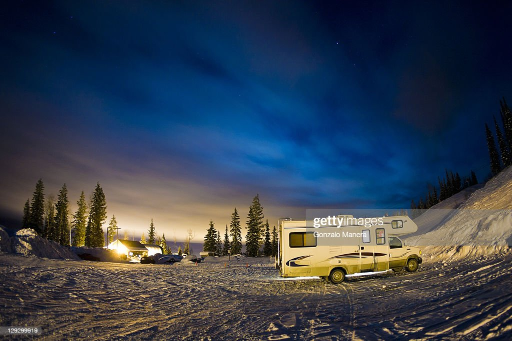 Recreational vehicle parked on hillside