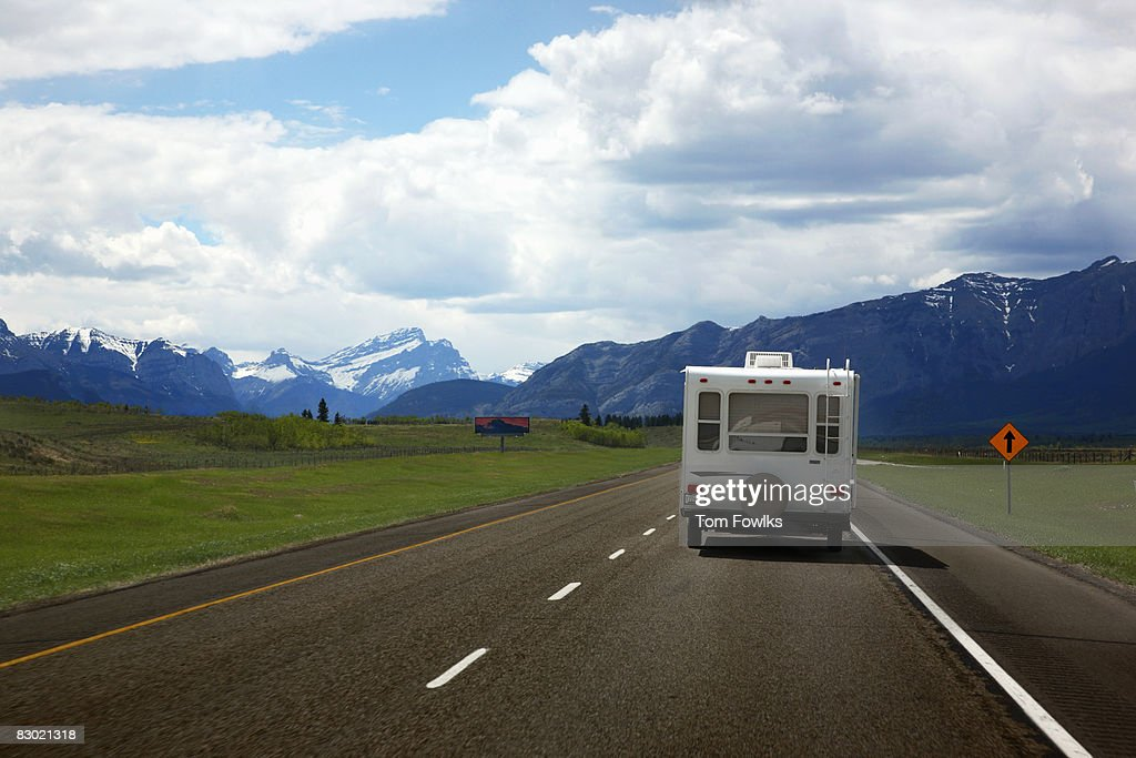 Recreational vehicle with mountains in background