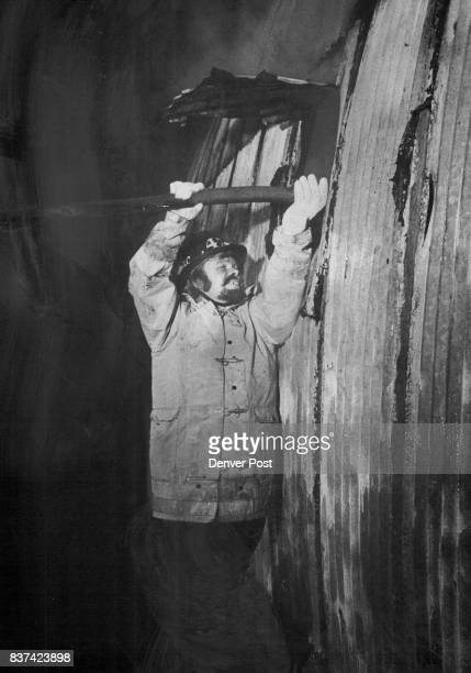 RecreationalVehicle Firm Damaged by Fire A South Adams County Volunteer fireman holds a hose to a hole in the side of a warehouse above at Mitchell...