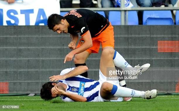 Recreativo Huelva's Cesar Arzo argues with Valencia's David Villa during a Spanish league football match at the Nuevo Colombino stadium in Huelva on...