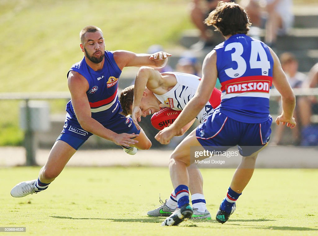 Recruit from the Hawks, Matt Suckling, tackles Jackson Macrae of the Bulldogs during the Western Bulldogs AFL intra-club match at Whitten Oval on February 13, 2016 in Melbourne, Australia.