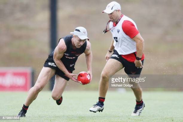 Recruit Jake Stringer sprints off with the ball during an Essendon Bombers AFL training session at the Essendon Bombers Football Club on November 27...