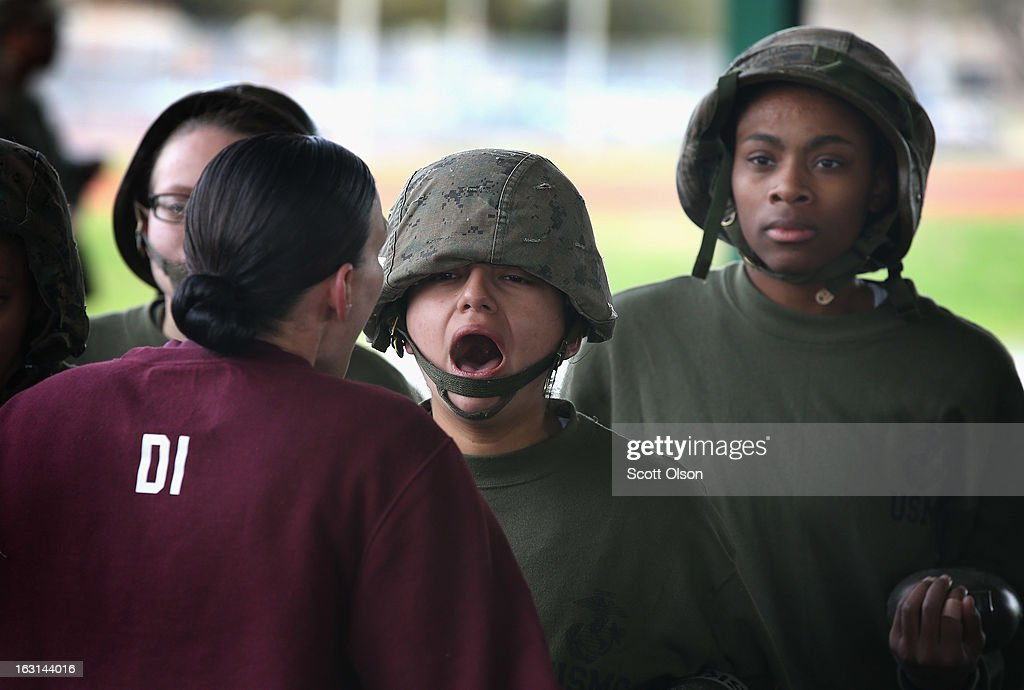 Recruit Miranda Limon of Fort Worth, Texas responds to a comment from her drill instructor during hand-to-hand combat training in boot camp February 27, 2013 at MCRD Parris Island, South Carolina. Female enlisted Marines have gone through recruit training at the base since 1949. About 11 percent of female recruits who arrive at the boot camp fail to complete the training, which can be physically and mentally demanding. On January 24, 2013 Secretary of Defense Leon Panetta rescinded an order, which had been in place since 1994, that restricted women from being attached to ground combat units. About six percent of enlisted Marines are female.