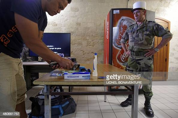 Moutot a recruit of the french foreign legion shows his for French shows