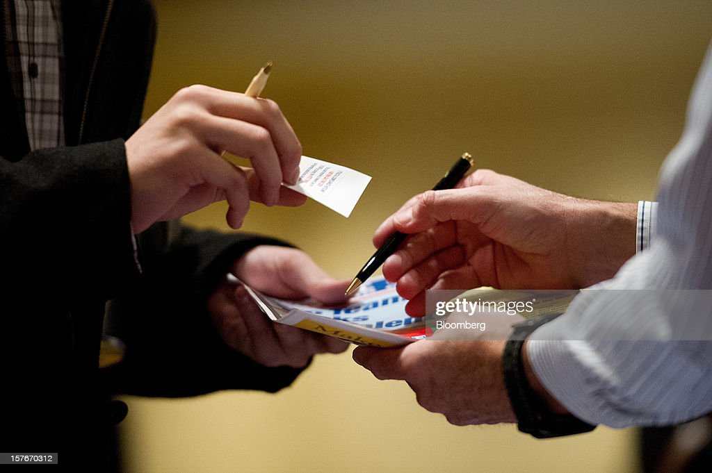 A recruiter, right, greets a job seeker during a HIREvent job fair in San Jose, California, U.S., on Tuesday, Dec. 4, 2012. The U.S. Labor Department is scheduled to release initial jobless claims data on Dec. 6. Photographer: David Paul Morris/Bloomberg via Getty Images