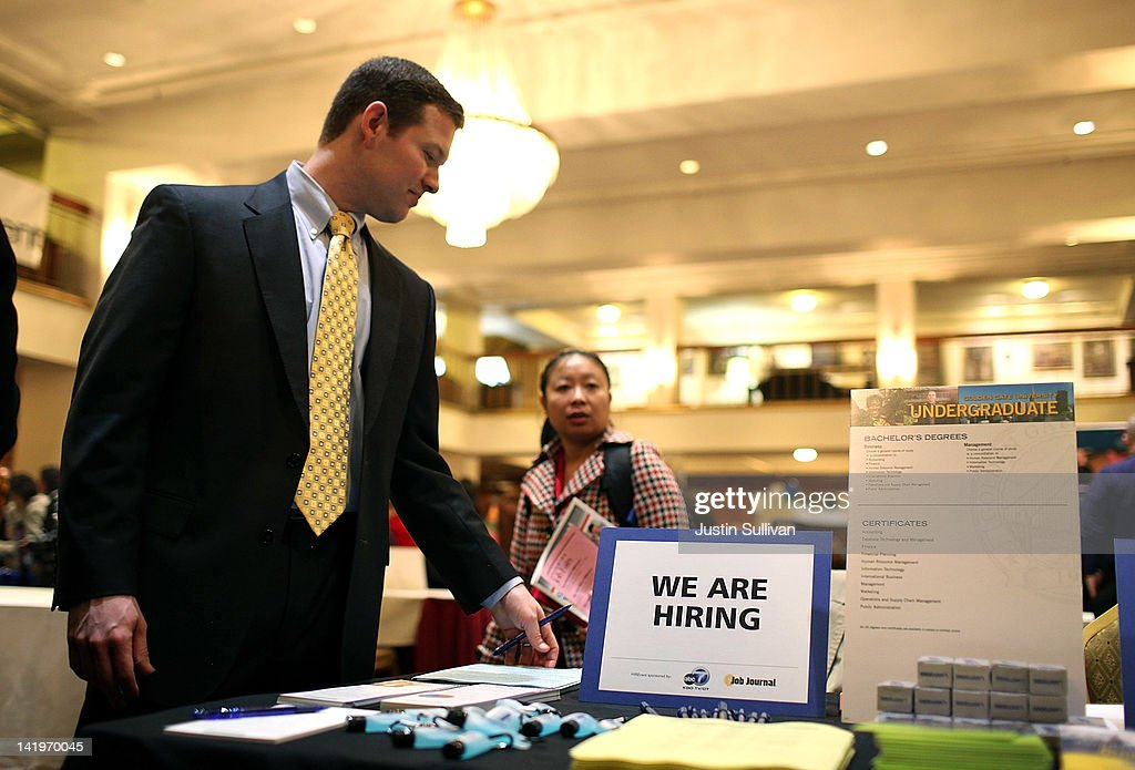 A recruiter sets up his table during the San Francisco Hirevent job fair at the Hotel Whitcomb on March 27, 2012 in San Francisco, California. As the national unemployment rate stands at 8.3 percent, job seekers turned out to meet with recruiters at the San Francisco Hirevent job fair where hundreds of jobs were available.