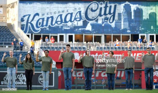 Recruits are sworn into the United States Army prior to the start of Monday's baseball game between the Kansas City Royals and Chicago White Sox on...