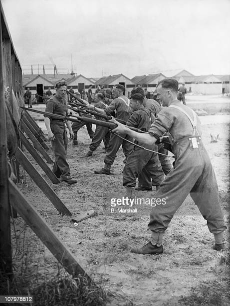 Recruits at bayonet practice at a resort in the northwest of England during World War II 25th July 1940